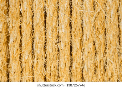 Background from sisal ropes. Golden natural sisal close-up.