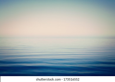 Background of sky and sea, sea is very calm with gentle ripples, instagram effect.