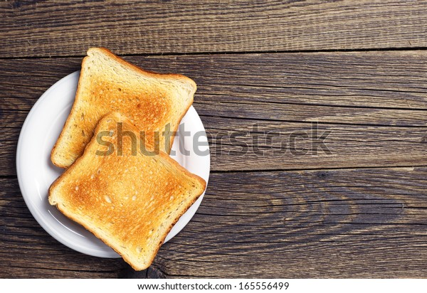Background with slices of toast bread and old wooden table