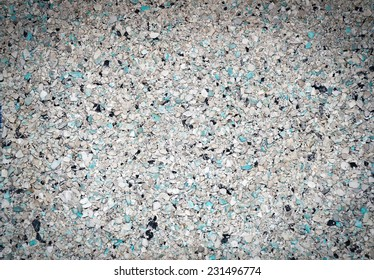 Background of small blue, gray, white and black small granules with vignetting effect as background