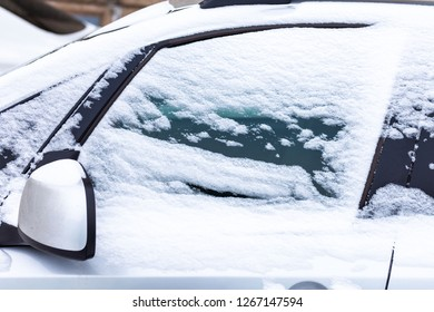 background, snow covered car window