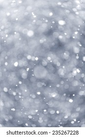 Background of snow flurry falling in winter with some motion blur