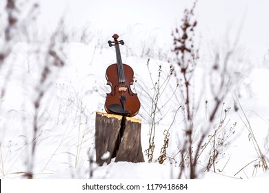 Background with snow and violin.