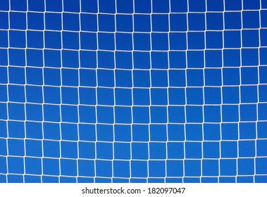 background of soccer net against blue sky