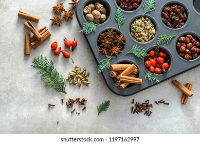 Background with spices. Baking with christmas spice - star anise, cinnamon sticks, cardamom, nutmeg.