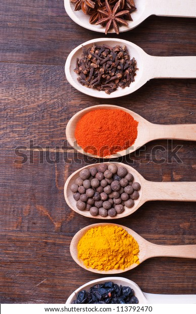 Background with spices ( turmeric , star anise , barberry , allspice , cloves , paprika)