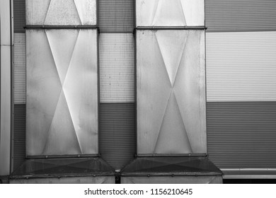 Background with square black and white ventilation tubes close
