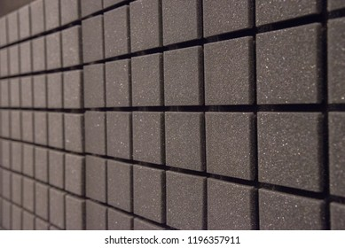 Background of square foam panels for sound insulation in the studio