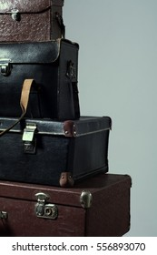 Background stack of old shabby suitcase. Concept traveler distant countries. Wardrobe trunk reportage photographer