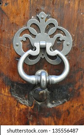 background stainless new knocker in wood old door