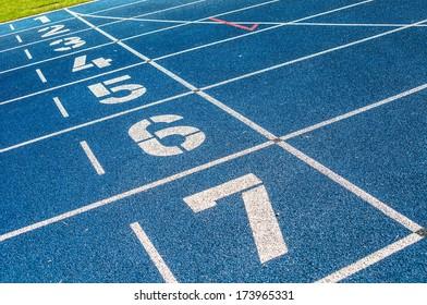 background of the start line of blue running tracks