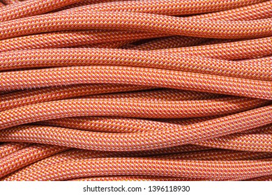 background of strands of coiled orange climbing rope