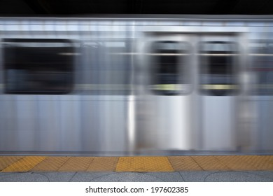 A background of the streaks of a fast moving train from the side.