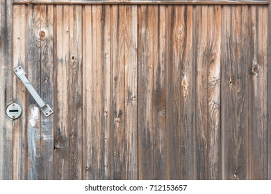 Background in style a rustic from old vertical wooden unpainted boards with the handle