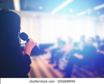 Background of successful beautiful women giving happy and fun professional speech in business conference. Use in workshop, training lecture, seminar event