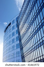 A background surface of modern glass buildings.