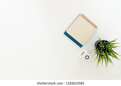 Background of a table with a flowerpot and a calendar