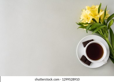 background for text with a cup of coffee and flower