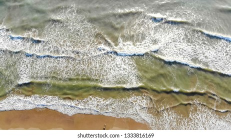 Background or texture. Aerial view ocean waves come to the shore