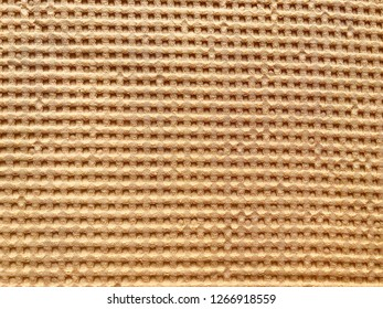 Background - texture of beige waffle fabric.