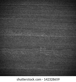 Background texture of black and white wood closeup with vignette