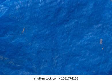 Background texture of blue plastic tarp