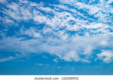 Background and texture of cloud above the blue sky