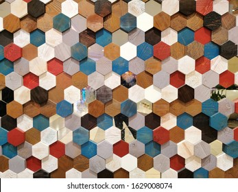 Background texture colorful hexagon shape and pattern of multicolor wooden honeycomb section for decorate wall, ceiling, wallpaper. In light and dark brown, red, blue, black with real wood style.