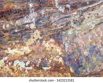 Background and texture of colorful surface of rusty slate rock plate
