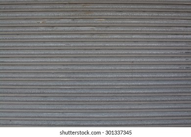 Background texture of corrugated metal gray iron for copy space or creative background.