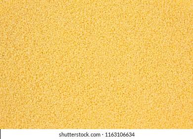 Background texture of couscous grains. Top view.