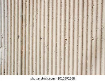 Background texture of cream corrugated iron wall or door with space for copy