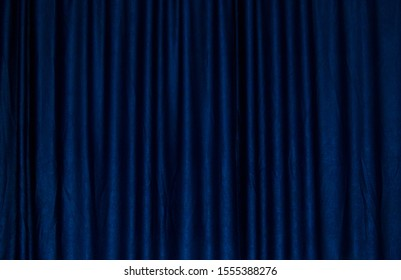 Background texture dark blue draped fabric with abstract pattern