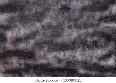 Background with texture, dark spots and cracks. Abstract monochrome image.
