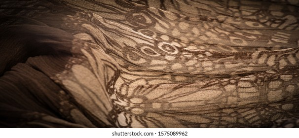 Background texture, decorative ornament, brown-beige silk fabric, floral pattern, corrugation, reef, undulation, undulation, ripples, a small wave or a series of waves on the surface of the fabric,