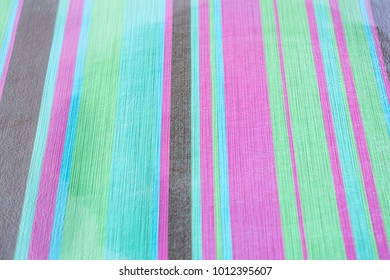 Background with texture and different colors and sizes of lines. Colors black, green, violet, light blue and green.