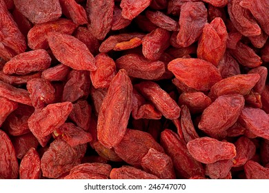Background texture of dried Goji berries, or wolfberries.