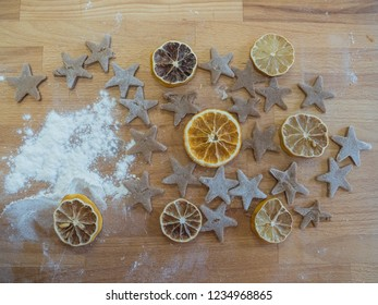 Background, texture. Dried orange slices and baked gingerbread  are waiting for Christmas on wooden table. Xmas