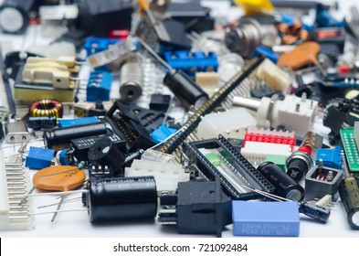 Background texture of electronic components (capacitors, resistors, diodes, transistors, potentiometer and chips)
