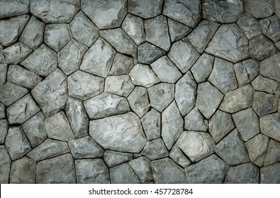 background and texture of granite stone wall surface