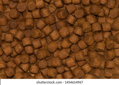 Background, texture of granulated animal feed.