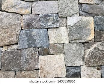 Background texture of grayish stone brick wall, Summer in Georgia USA.