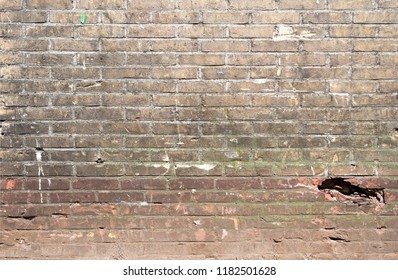background texture of grunge brick wall at industrial building with cracks