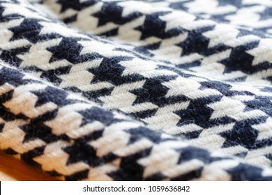 Background texture of hound's-tooth check pattern fabric made of cotton or wool closeup