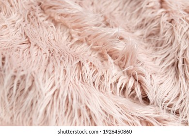 background texture. llama fur. artificial fur. pink fur