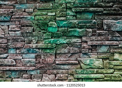 background texture of masonry decorative stones with shades of green, blue, emerald