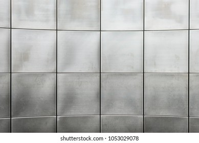 Background texture of metallic grid of squares.