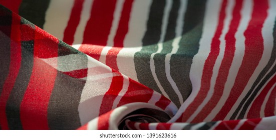 Background texture. multicolored striped silk fabric. Mexican coloring theme bright colored striped pattern with abstract stripes