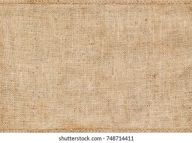 Background and texture of natural brown Sackcloth with Stitches Seam.