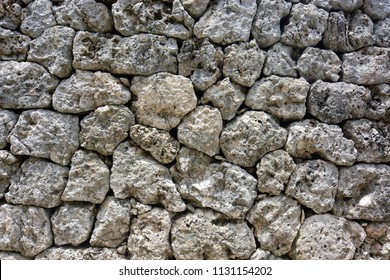 Background texture from a natural rock wall of fitted stones built without mortar